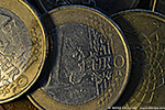 Euro coins with mysterious press cut